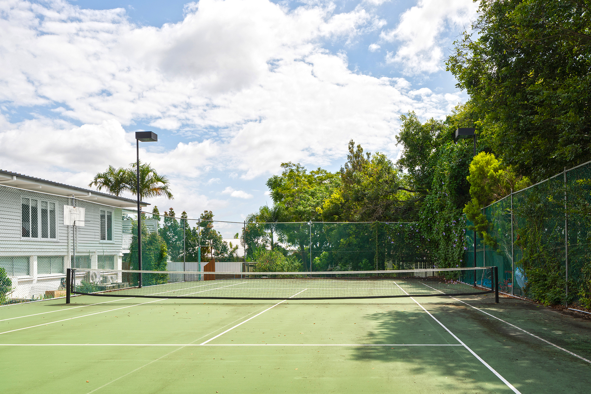 Charming Clayfield Queenslander with a Rare Full-Size Tennis Court