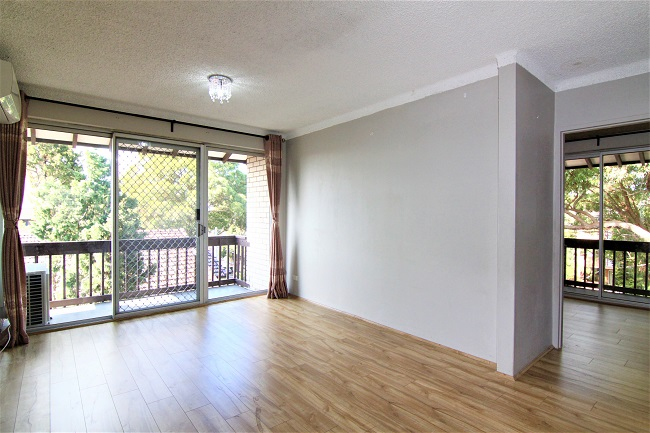 DEPOSIT TAKEN | Top floor renovated 2 bedroom unit, steps to shops and station