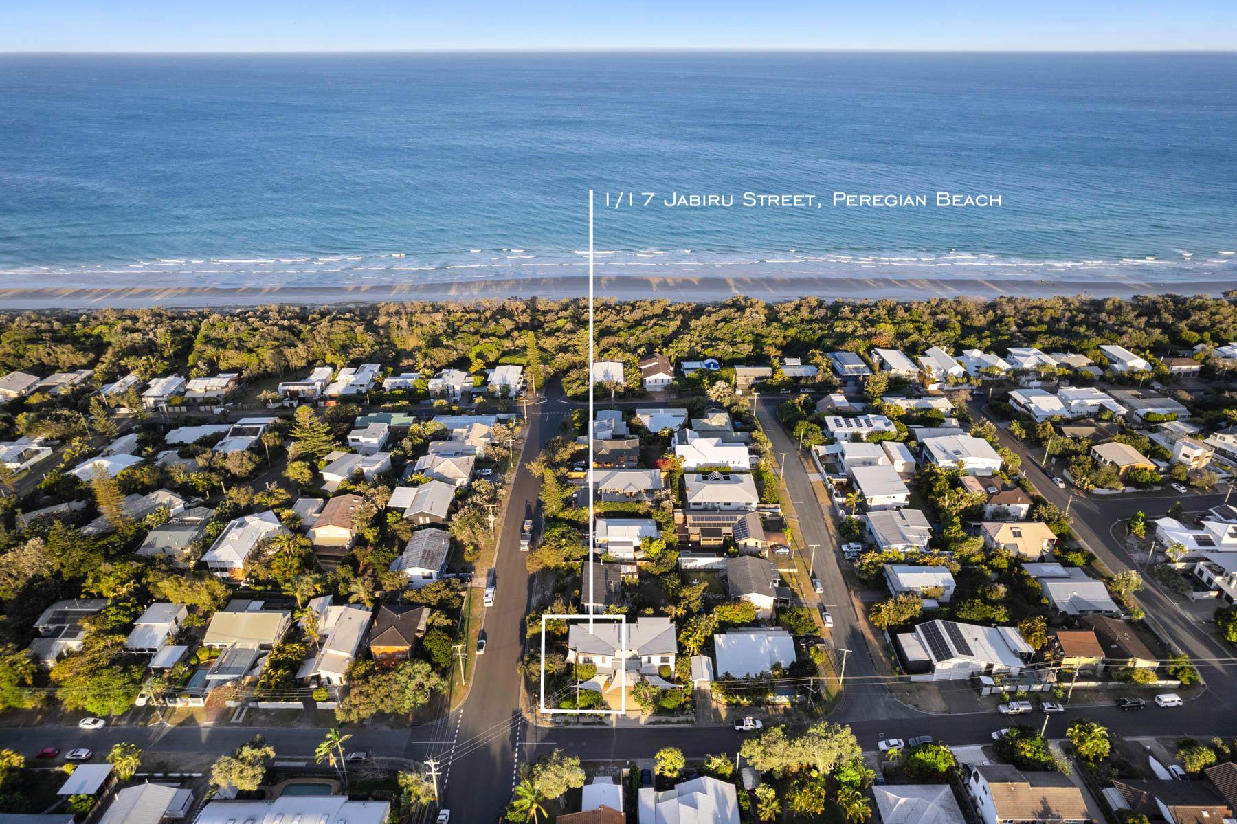 Modern duplex in enviable beachside locale