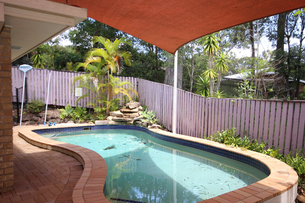 SECLUDED 3 BEDROOM HOME WITH INGROUND POOL.