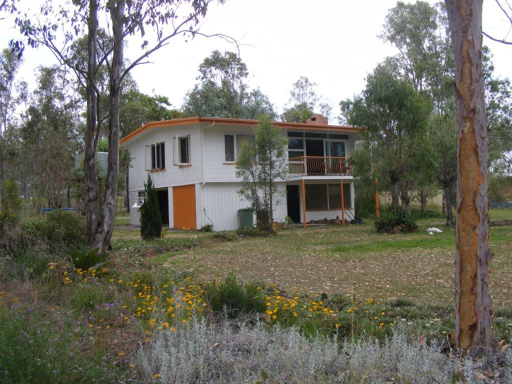 FOR AUCTION 1 ACRE HIGH SET HOME WITH TOWN WATER