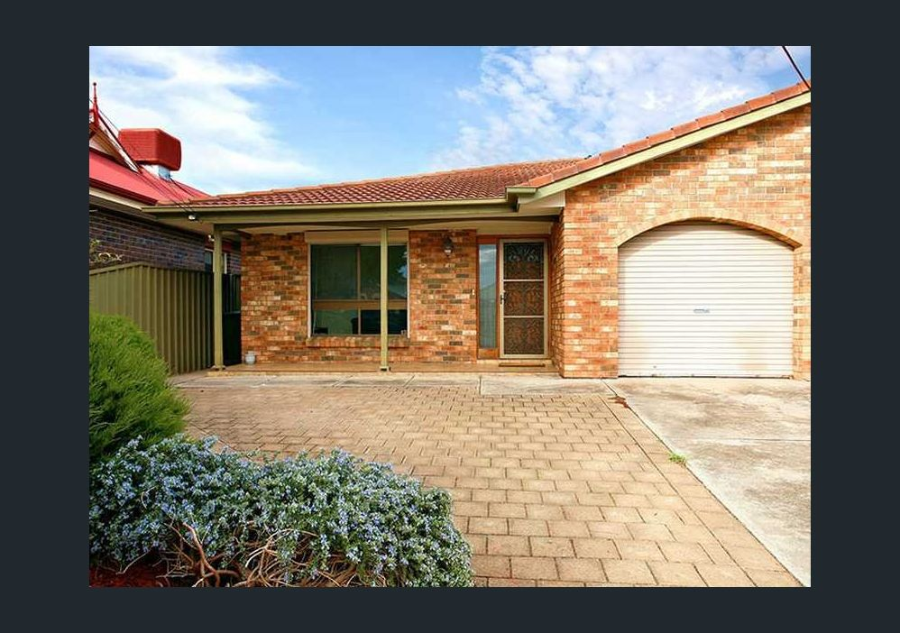 Attractive Low Maintenance Home at Convenient Location
