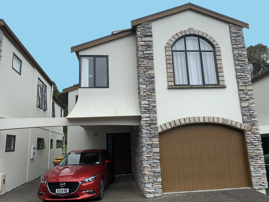 Stylish, spacious, two level executive townhouse with private views over bush reserve