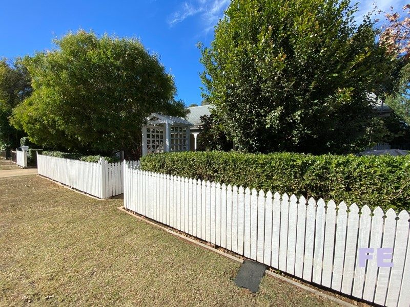 Gorgeous Quality home complete with a white picket fence