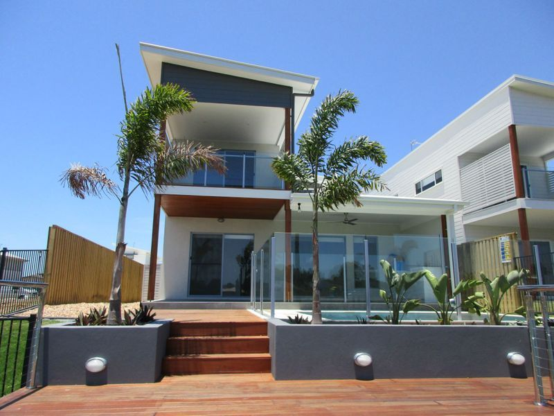 A NEAR NEW EXECUTIVE WATER FRONT HOME WITH POOL