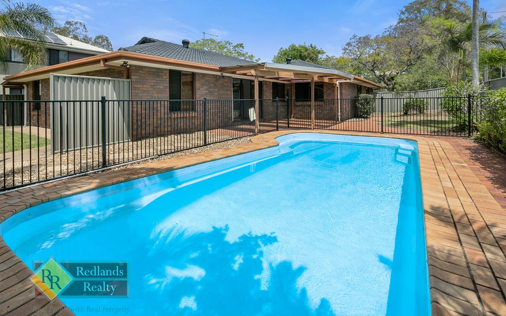 Large spacious low set brick home with in ground pool.
