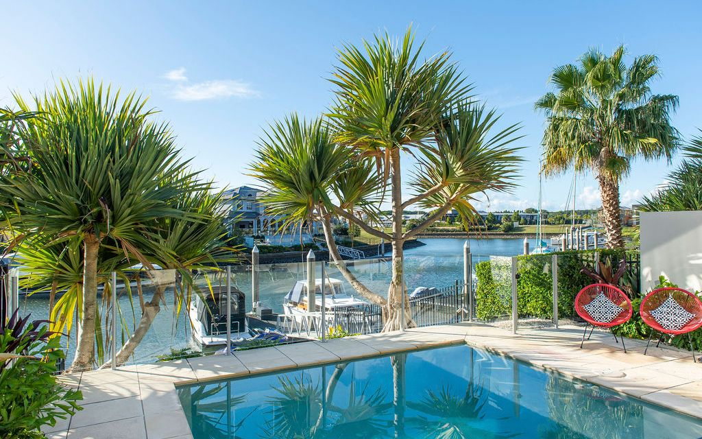 IMMACULATELY PRESENTED FULLY RENOVATED, NORTH TO WATER HOME WITH POOL AND PONTOON AND GOLF BUGGY