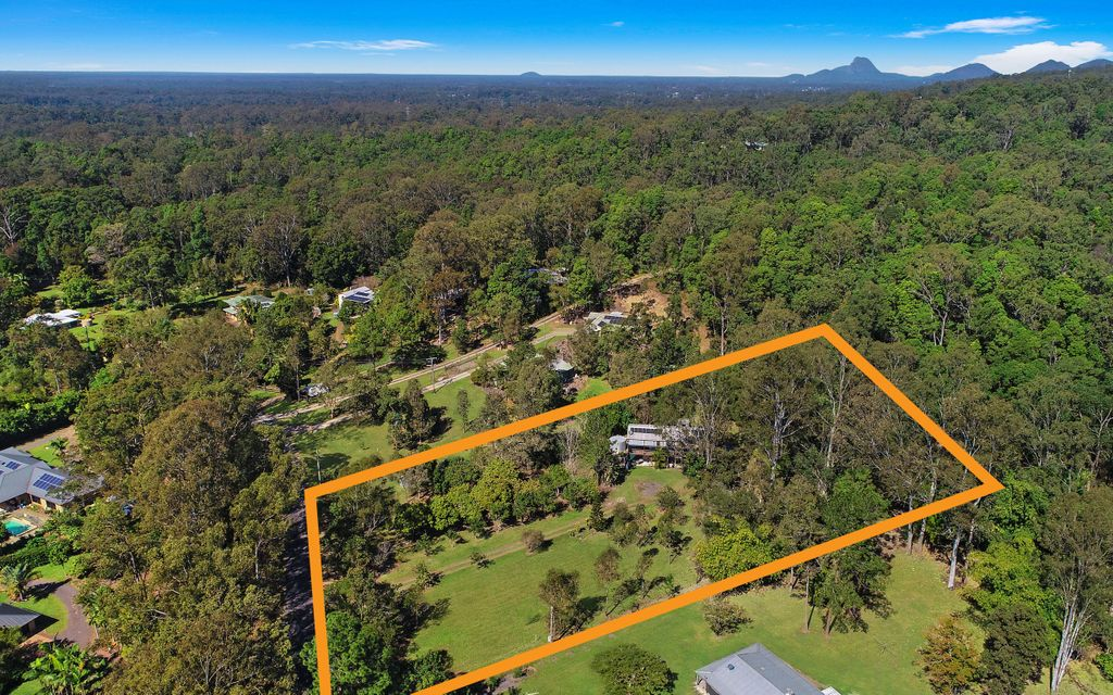 Central acreage with dual living property to suit renovator!