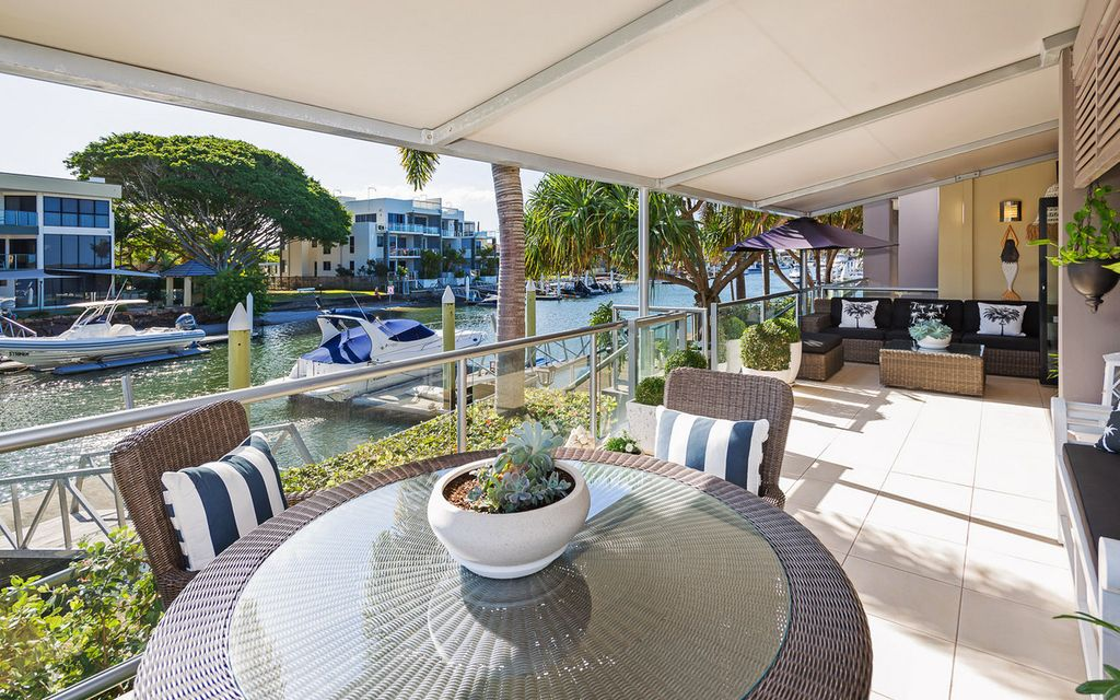 Absolute Canal Front Luxury with Three Car Garage!