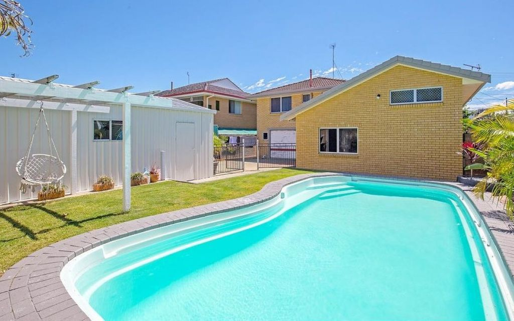 FAMILY HOME WITH EXCELLENT GARAGING AND STORAGE – WALK TO THE WATER!