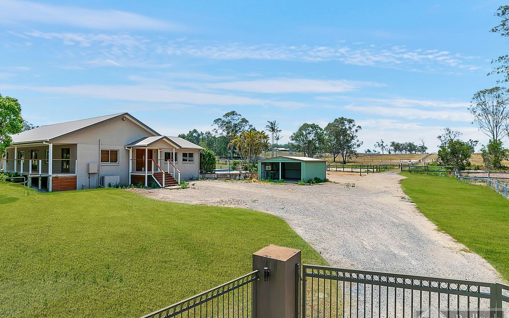 HUGE HOME !! HUGE LAND !! HORSE PADDOCKS !! THIS HOME HAS IT ALL !!