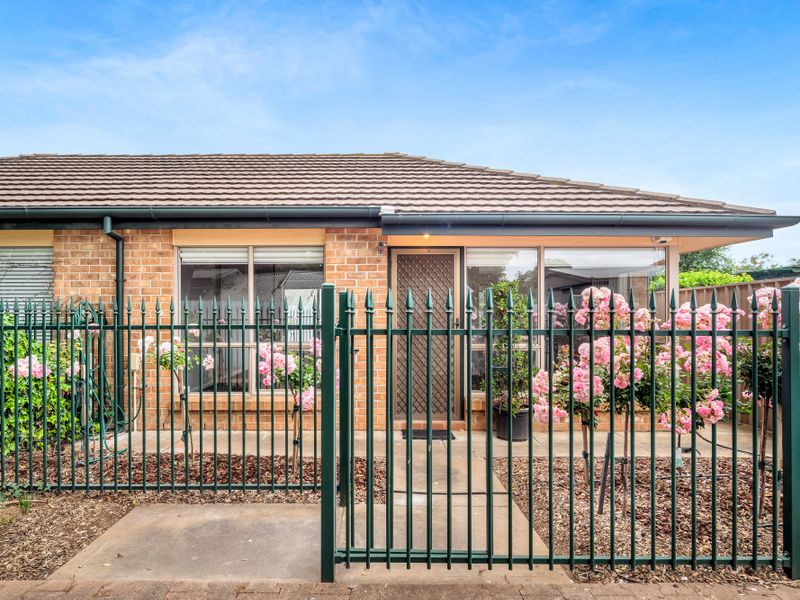 Updated Unit with secure front and rear yard