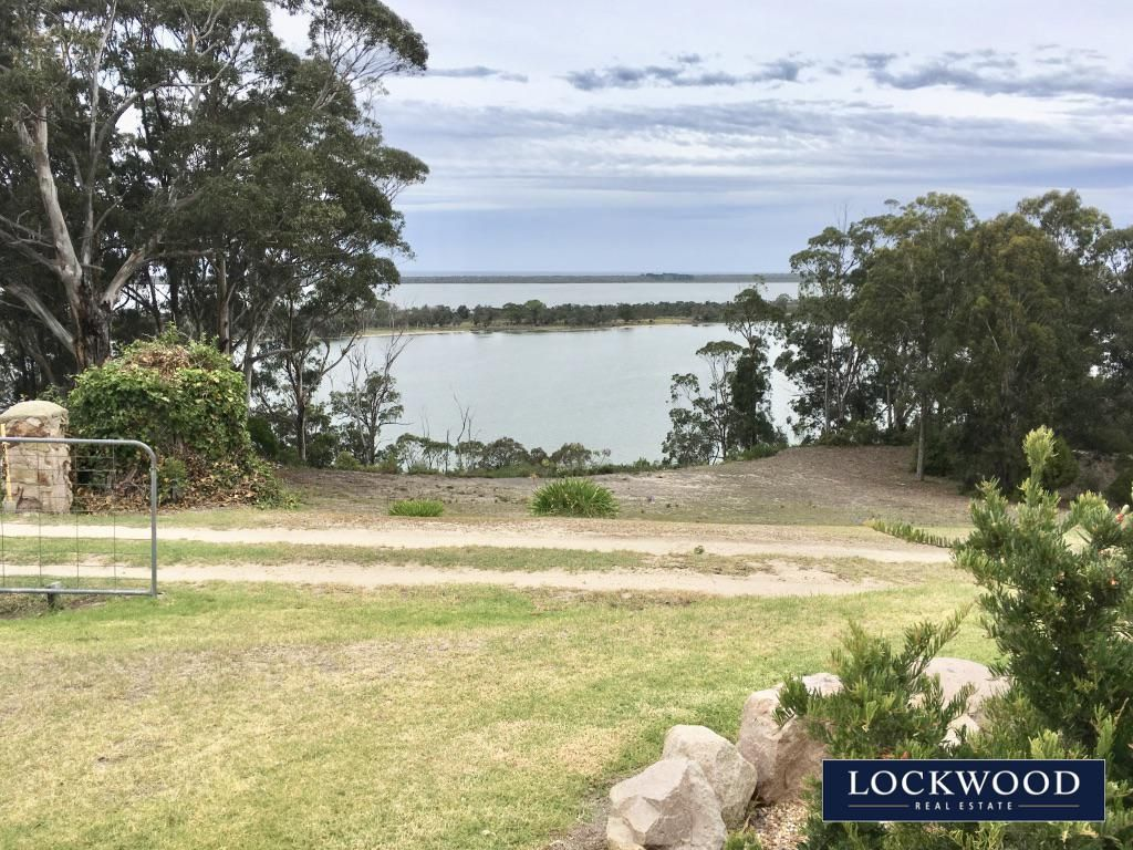 WATERFRONT ESCARPMENT PROPERTY WITH UNINTERRUPTED VIEWS TO THE GIPPSLAND LAKES,  BASS STRAIGHT AND BEYOND……..