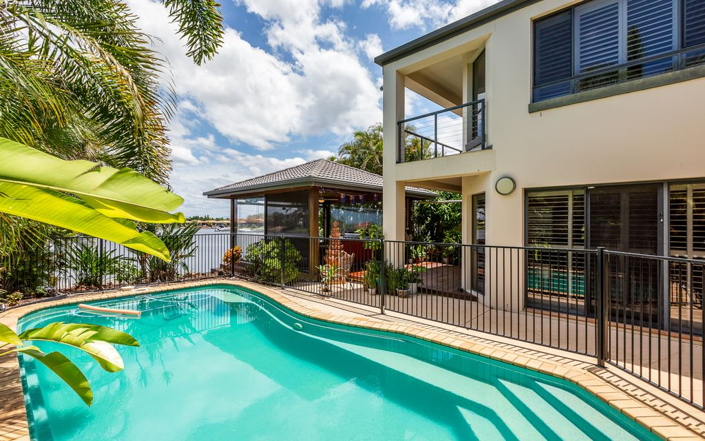 4 BEDROOM + STUDY HOME – WATERFRONT, PONTOON & POOL IN GATED PENINSULA ESTATE