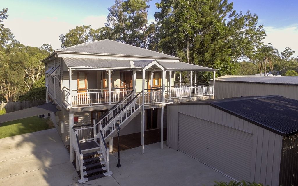 SPRAWLING QUEENSLANDER HOME ON 2 LEVELS OF LUXURIOUS LIVING-POOL-SOLAR POWER-SHED