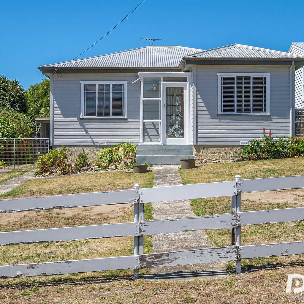 RARE OPPORTUNITY – RENOVATE, DEVELOP OR ENJOY THE LARGE YARD