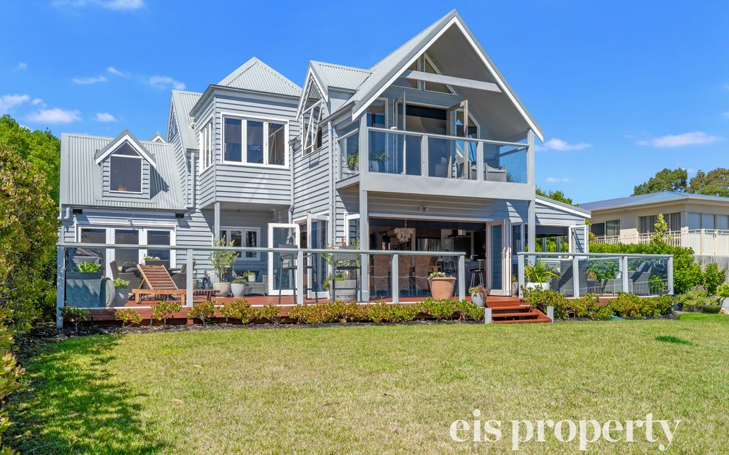 Love at first sight when you glimpse this classic Hampton style home