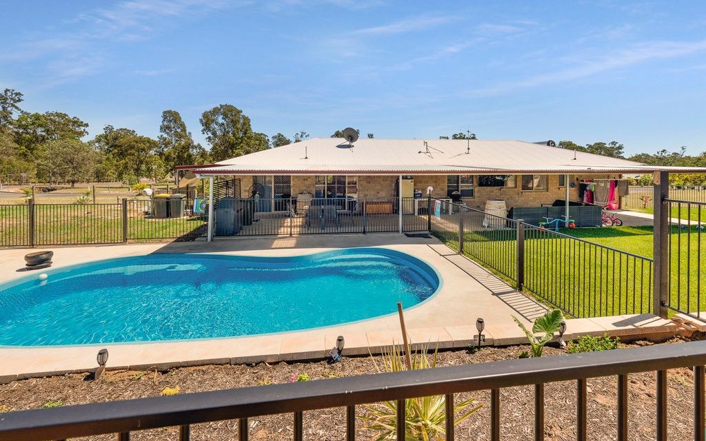 FOUR BEDROOM BRICK WITH SHEDS & POOL!