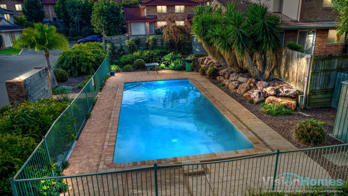 Townhouse in a secure gated complex with two resort style SWIMMING POOLS!