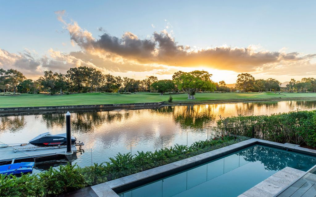 STUNNING SINGLE LEVEL WATERFRONT HOME WITH GOLF COURSE VIEWS