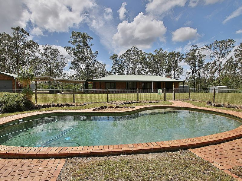 FIRST TIME ON THE MARKET! 3 BEDROOM HOME ON 10+ ACRES AND A POOL!