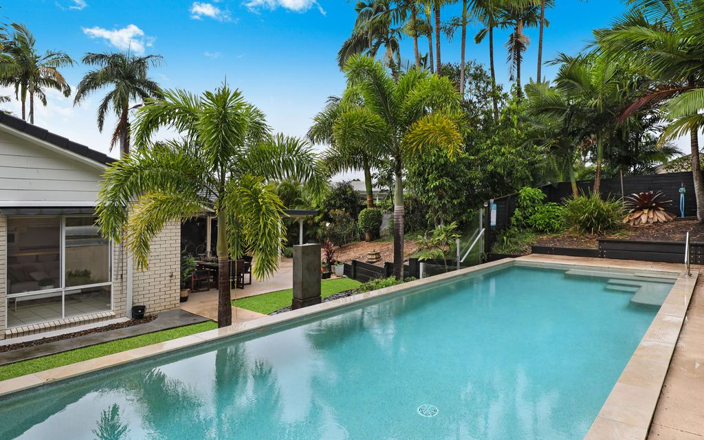 Tranquil tropical single level home with resort swimming pool