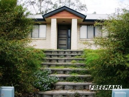 MODERN 3 BEDROOM HOME IN TOWN ON AN ACRE!