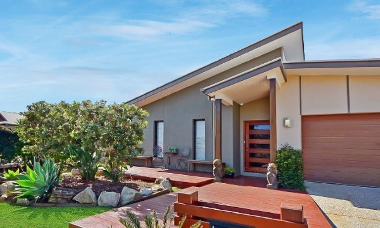Stylish designed single level home in sort after locale