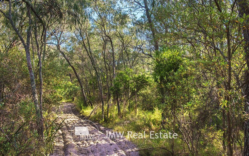 WALKING DISTANCE TO BEACH – OVER 1 ACRE