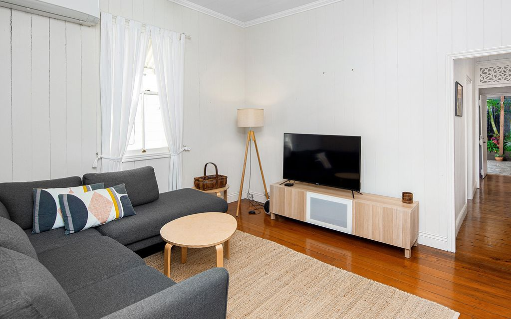 FULLY FURNISHED – ENTICING COTTAGE CHARM IN VIBRANT INNER-CITY LOCALE