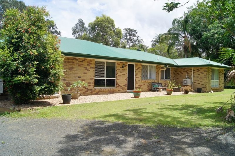 Well-maintained home with pool & shed