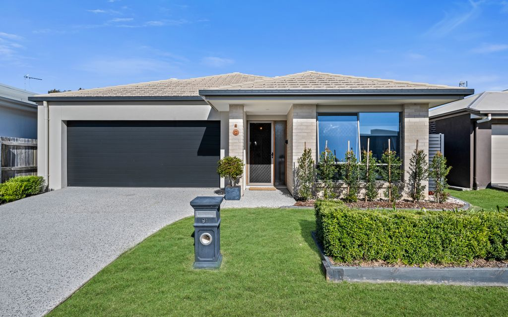 Family Home nestled in established gardens with Bush backdrop