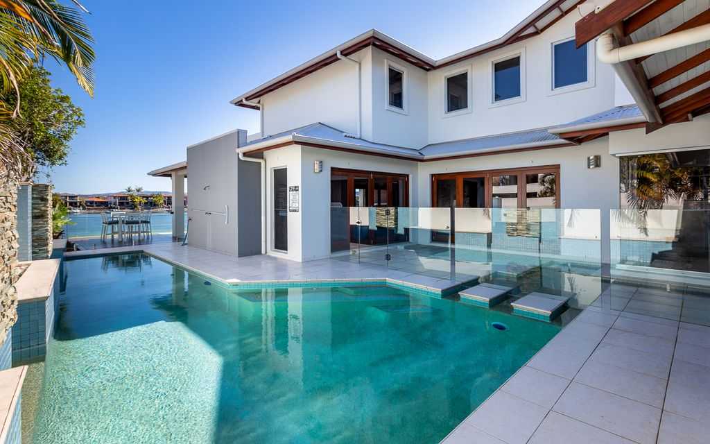 SPACIOUS WATERFRONT HOME WITH POOL & PONTOON IN GATED ESTATE