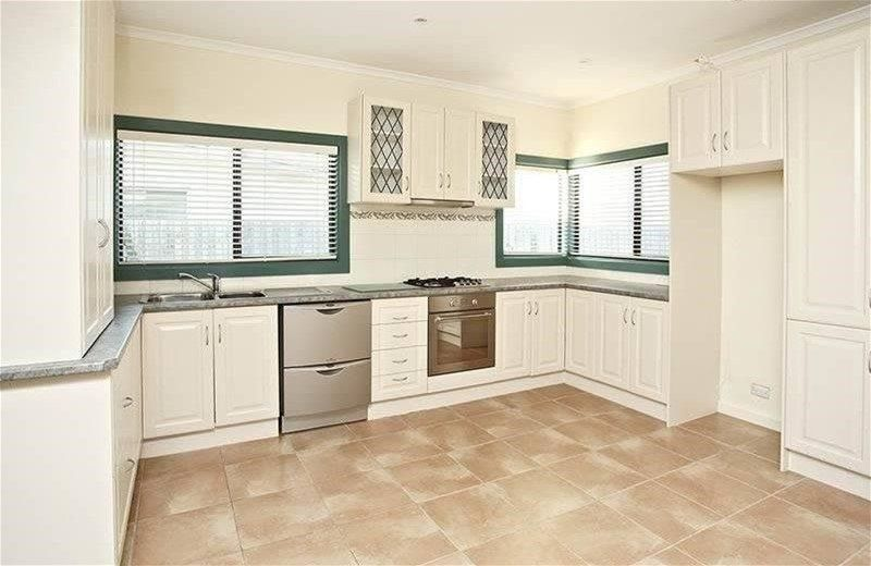 Don't be deceived….Updated kitchen, two living rooms and 3 bedrooms