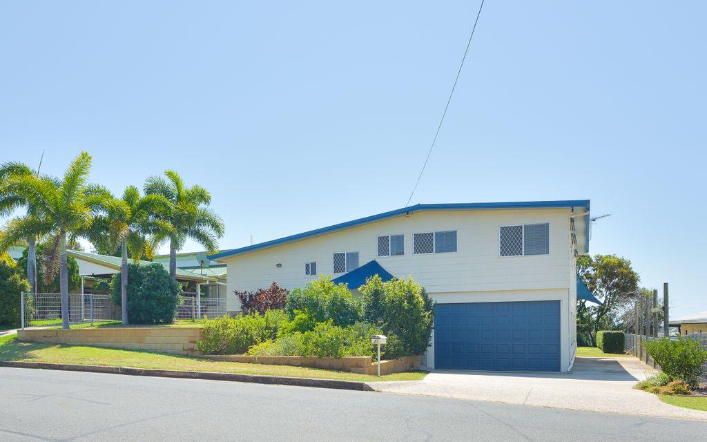 Hilltop Haven…a great family home with huge garage/workshop!