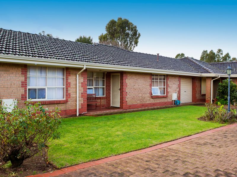 Stylish, large solid brick 2-bedroom unit in small group.