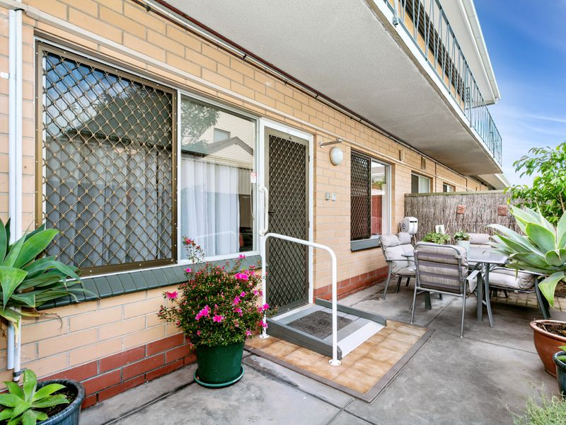 Quality ground floor solid brick unit with carpark