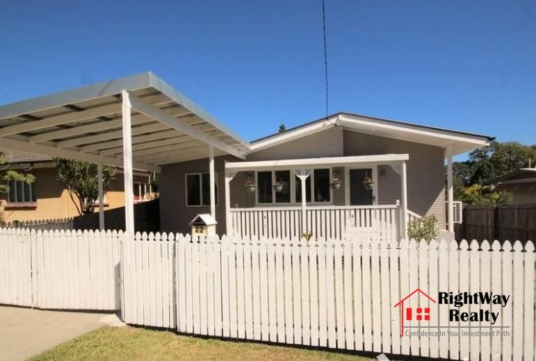 Cute Cottage With White Picket Fence