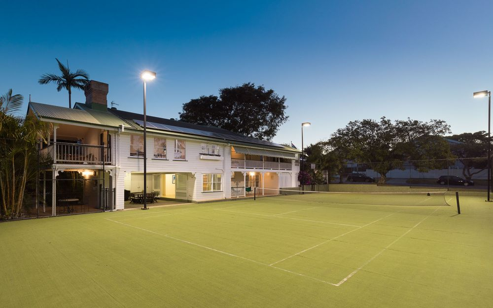 Expansive 1,222sqm two level Queenslander with tennis court in quiet family friendly street.