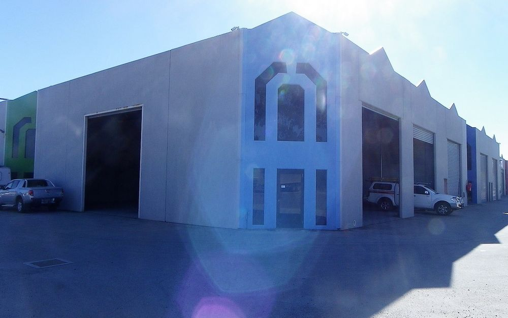High Ceiling, Large Warehouse Facing Bruce Highway