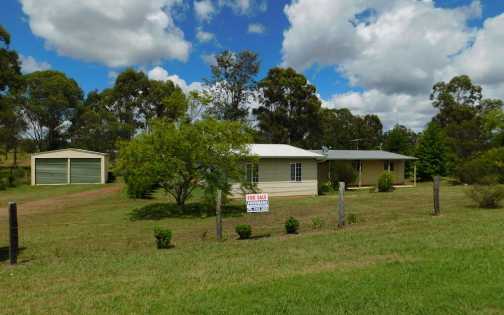 OVER 2.5 ACRES WITH TOWN WATER – MODERN ACREAGE MINUTES TO TOWN