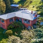 Brick home, separate chalet & 2 titles