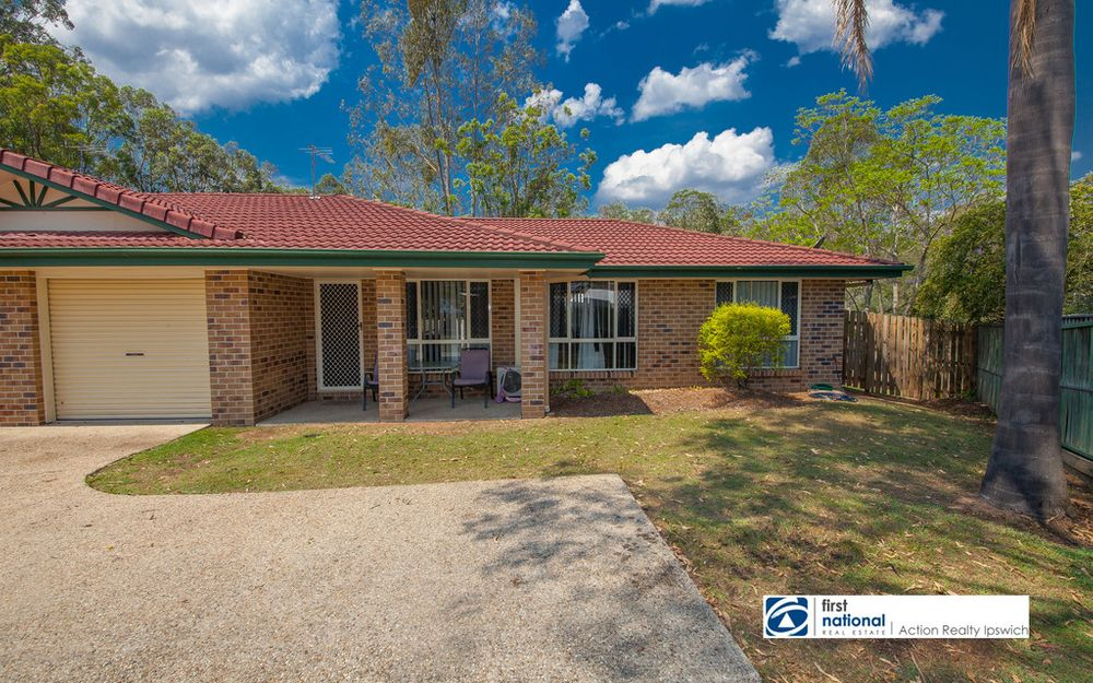 THREE BEDROOM LOWSET BRICK HOME IS A QUIET STREET IN BRASSALL