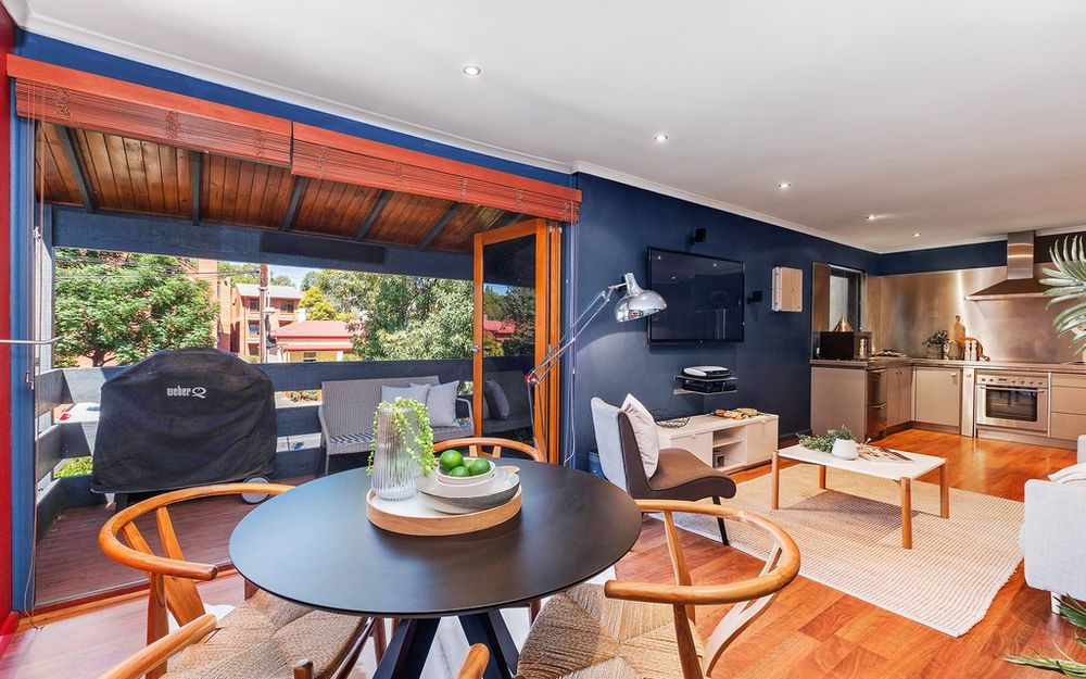 This stylish urban pad boasts a sleek and modern update with heated outdoor entertaining.