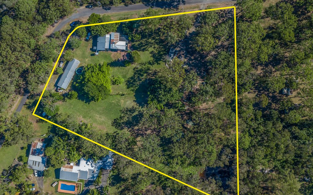 Great Location on over 3 Acres with Dam!