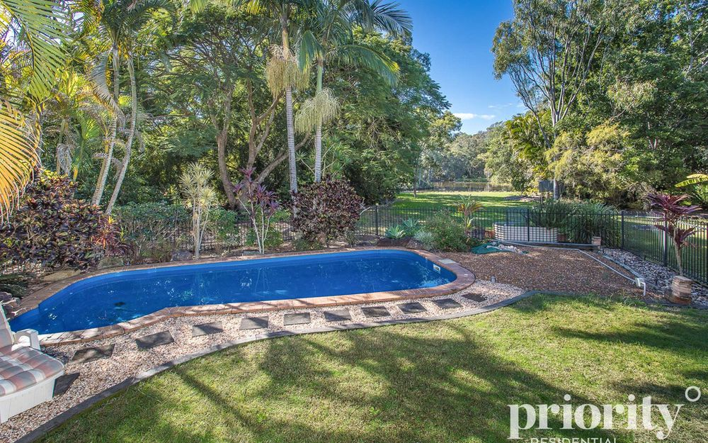 Unrivalled Backdrop! Pool, Sheds & Lush 3/4 Acre – Must Be Sold!