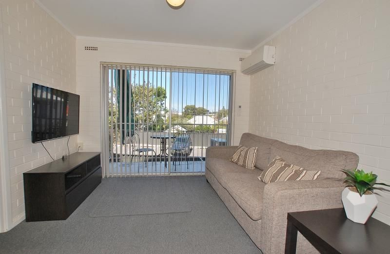FIRST FLOOR APPOINTMENT IN CONVENIENT LOCATION CLOSE TO CBD!