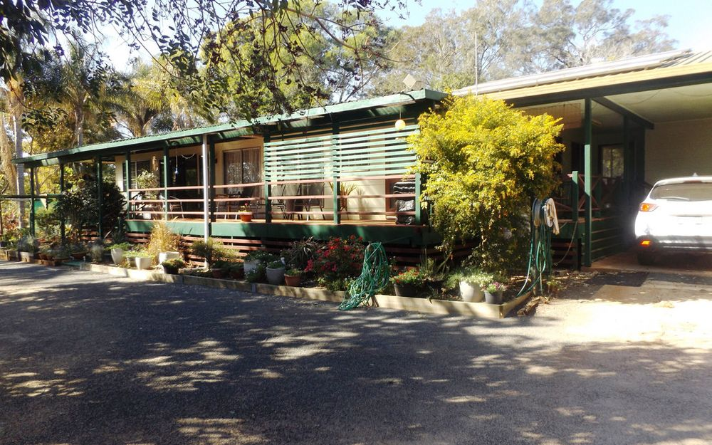 5 acres, steel frame home, under 10 minutes to town