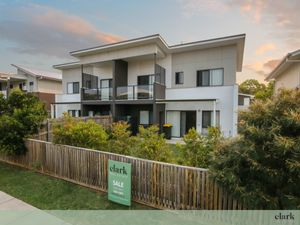 A Must See- Rare Double Garage and Street Frontage!