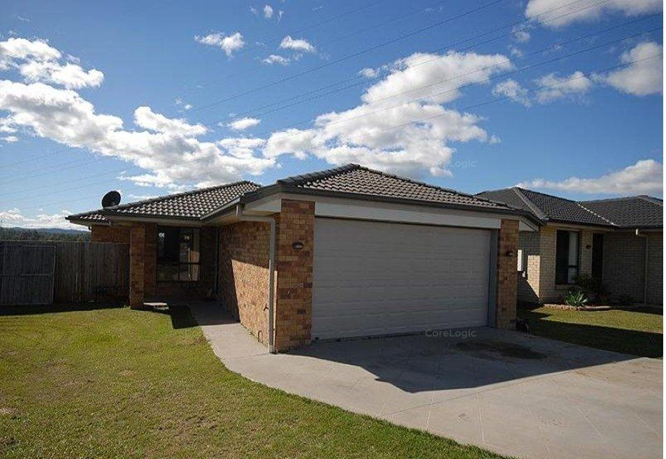 LARGE LOWSET BRICK FAMILY HOME